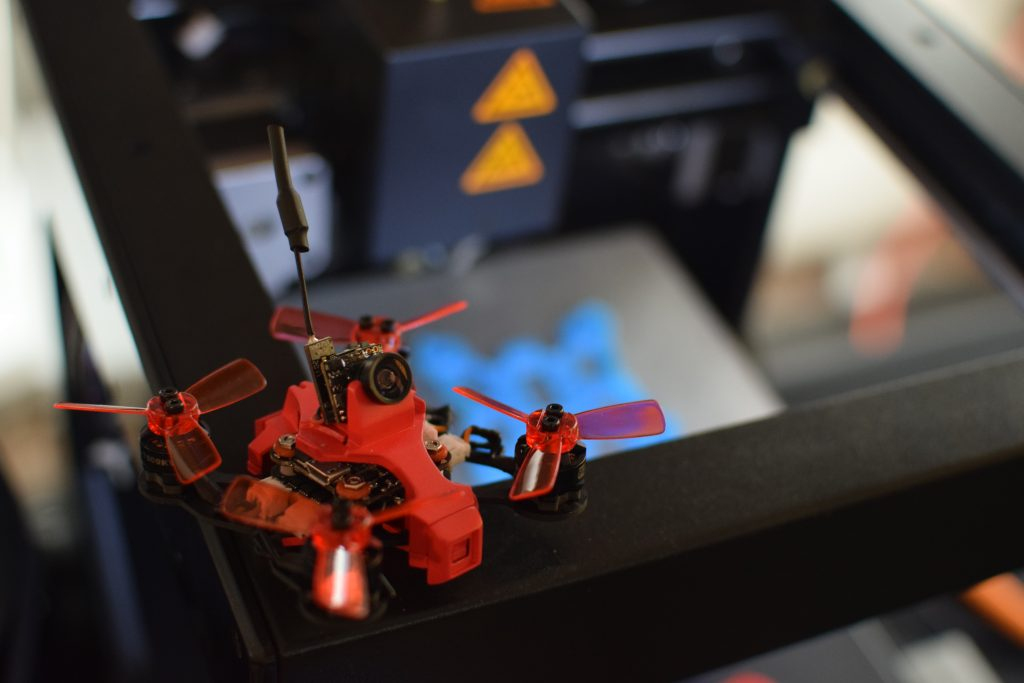 Drone, CES, Drone Rodeo. The RC EYE Imprimo sits on a 3D printer, which created the drone frame.