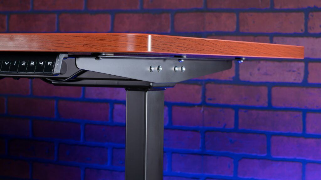 Aimezo's standing desk uses a cherry tabletop and black frame for a modern style that blends in with most aesthetics.