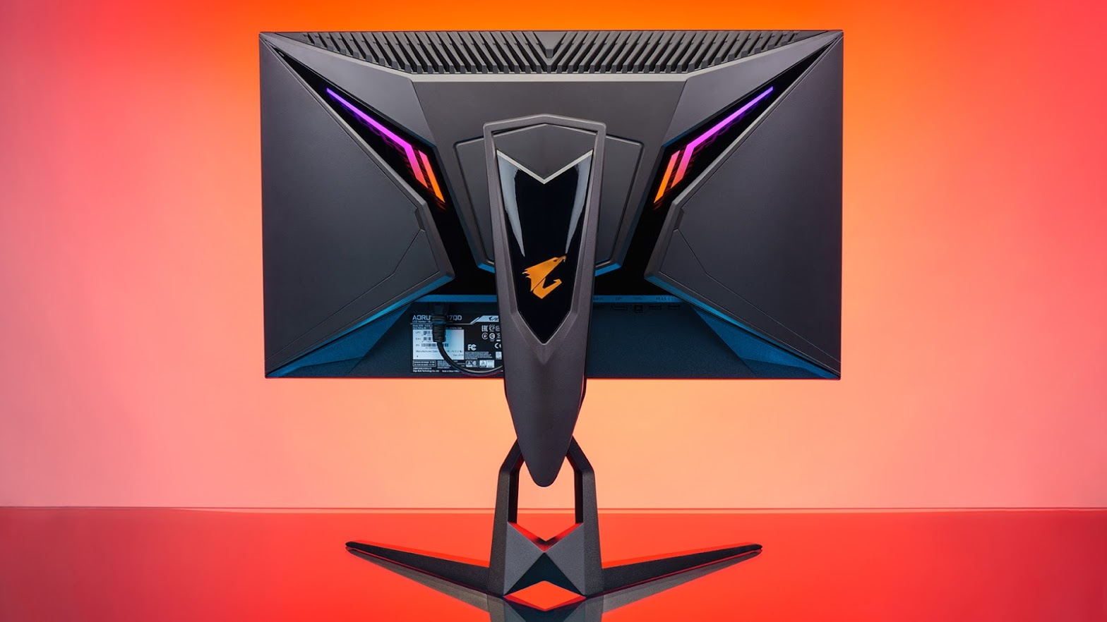 back of the aorus monitor in a red RGB-lit background