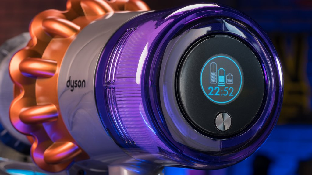 The Dyson V11 cordless vacuum's LCD screen displays the current cleaning mode, estimated remaining battery life, and charging status.