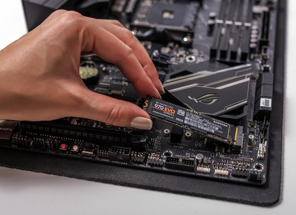 A Female Hand Installing an M.2 SSD hard drive into Its Motherboard Slot, Best Storage for Desktop PCs