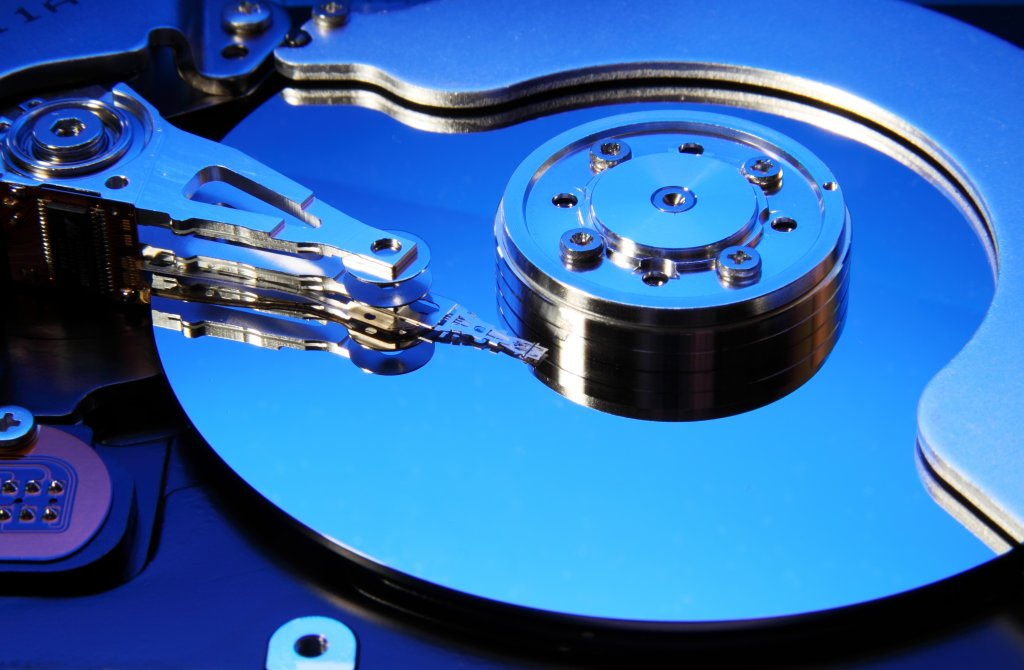 Close-up view of an opened hard drive (toned in blue), best storage for desktop PC