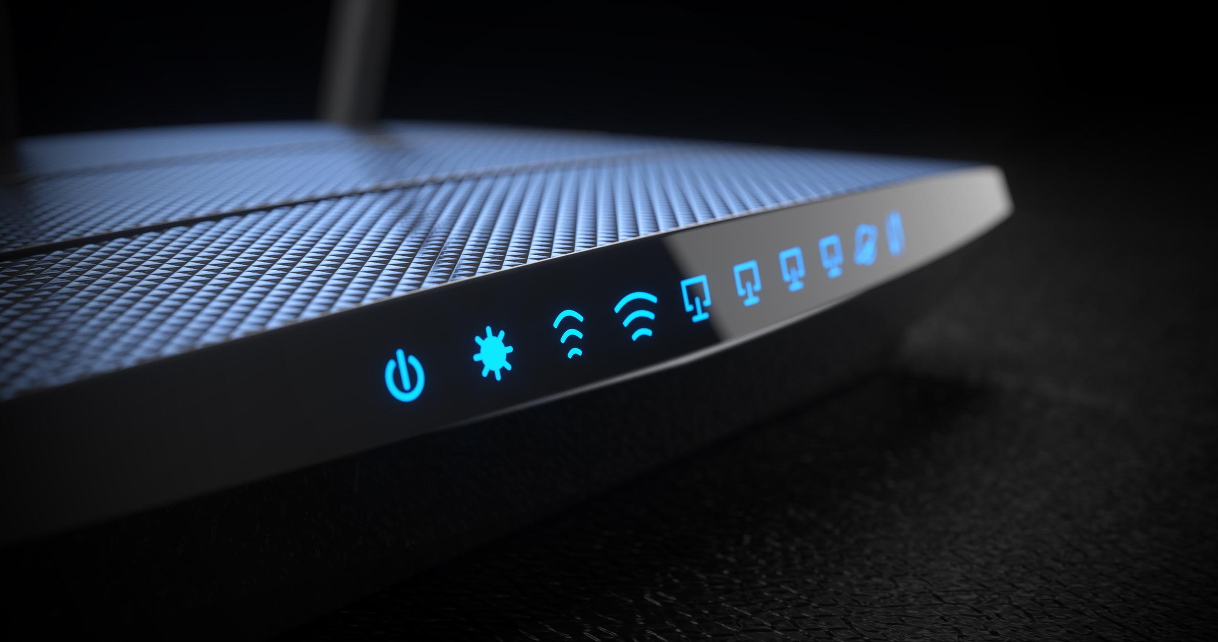 Black Wi-Fi wireless internet router on dark background